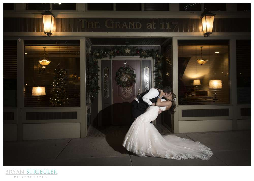 Arkansas Winter Wedding kissing in front of the Grand at 117