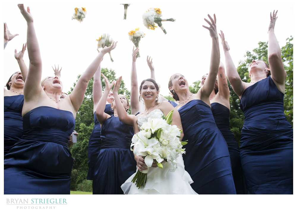 bridal party photos bridesmaids tossing flowers