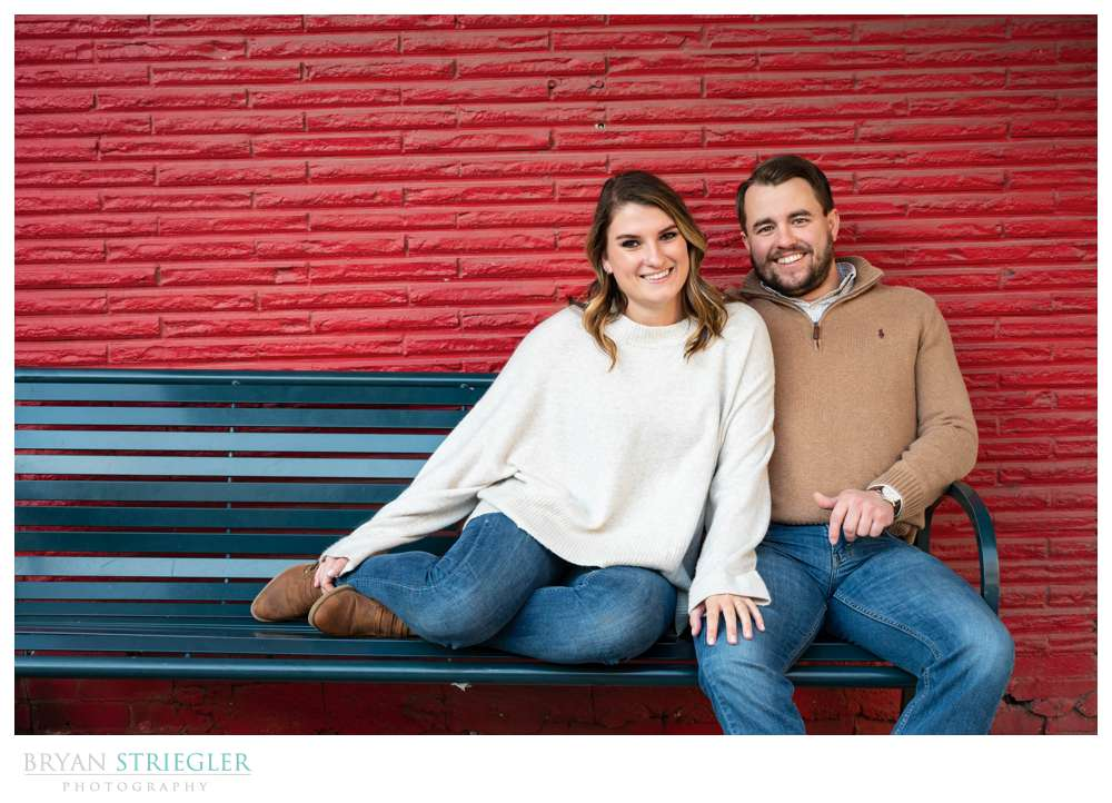 engagement photo with red brick
