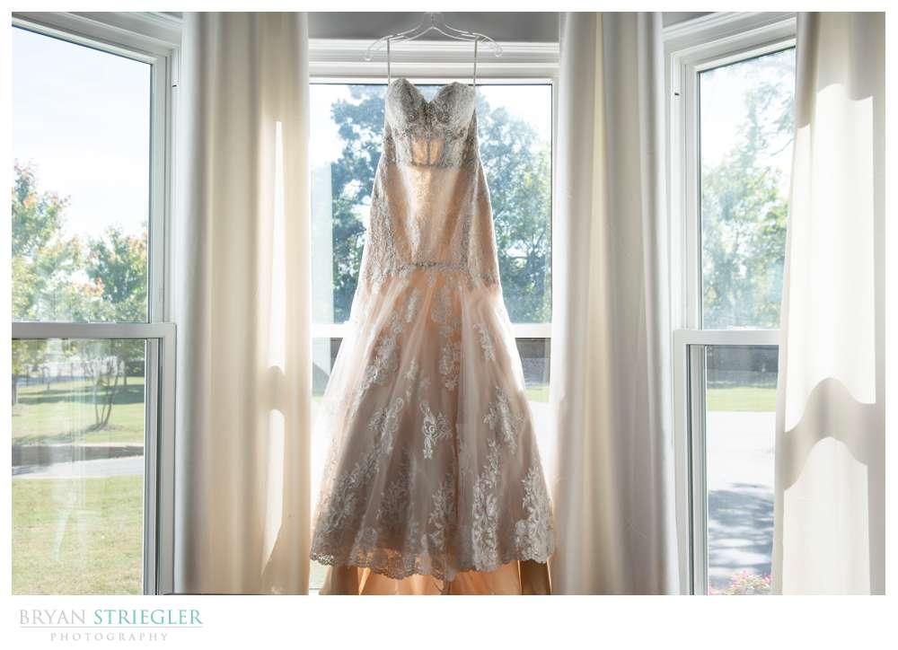 dress hanging in window