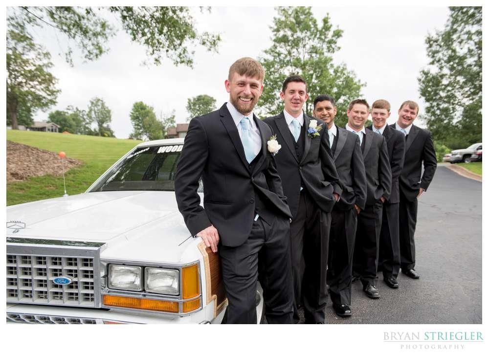 groomsmen with station wagon