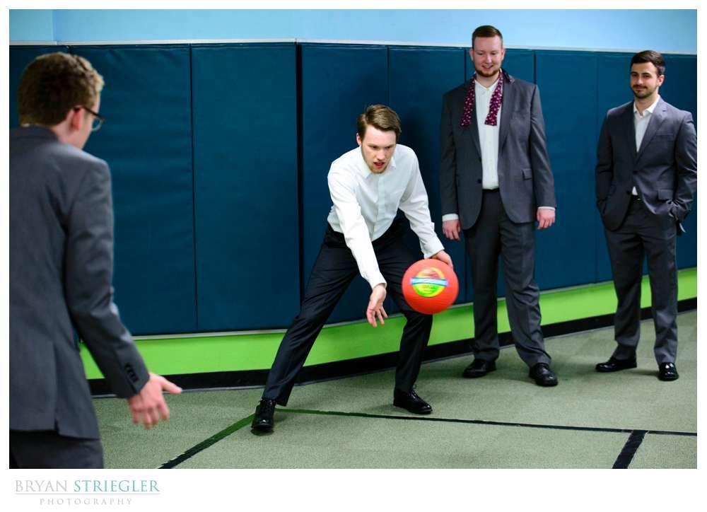 groomsmen playing dodgeball before wedding ceremony