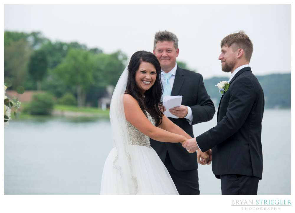 bride laughing at groomsmen prank