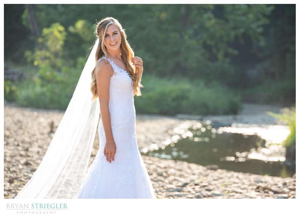 bridal portrait in creek