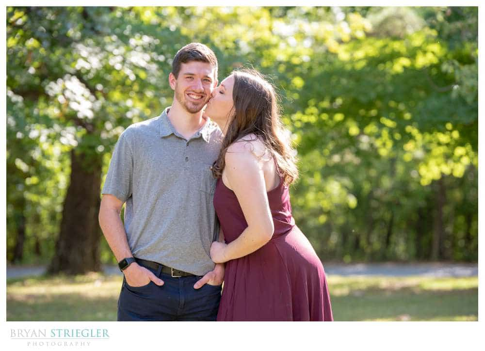 kissing fiance on the cheek