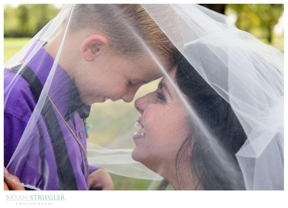 bride and son under veil
