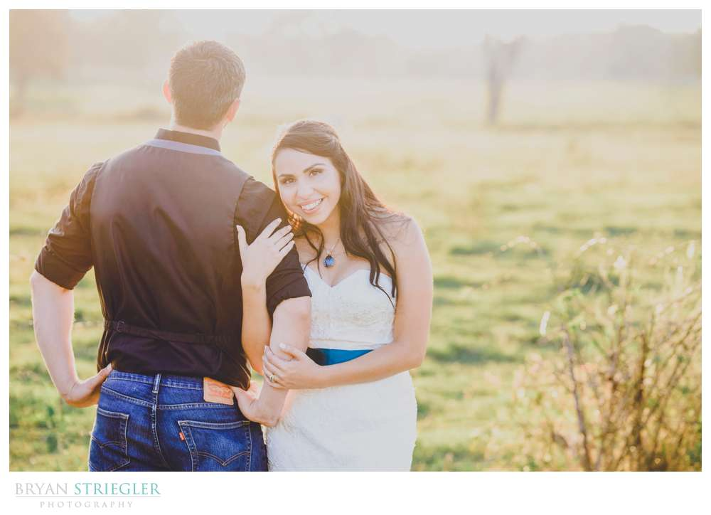 Bride and Groom in field at Cypress Barn
