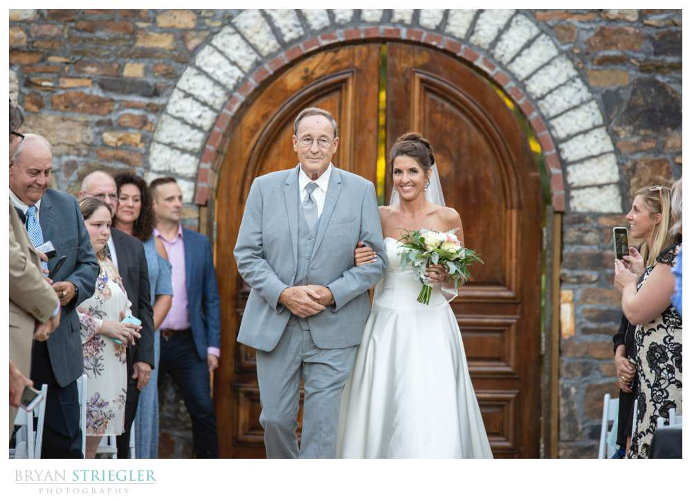 father and bride walking