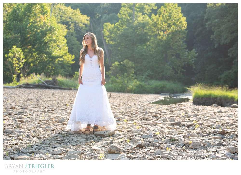 bride walking in creek bed