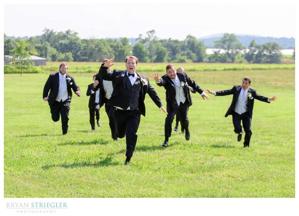 groom running from groomsmen
