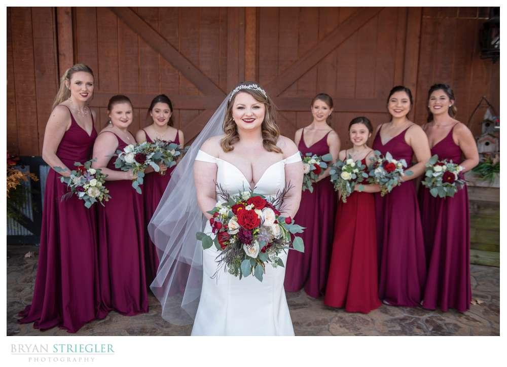 bride in front of bridesmaids