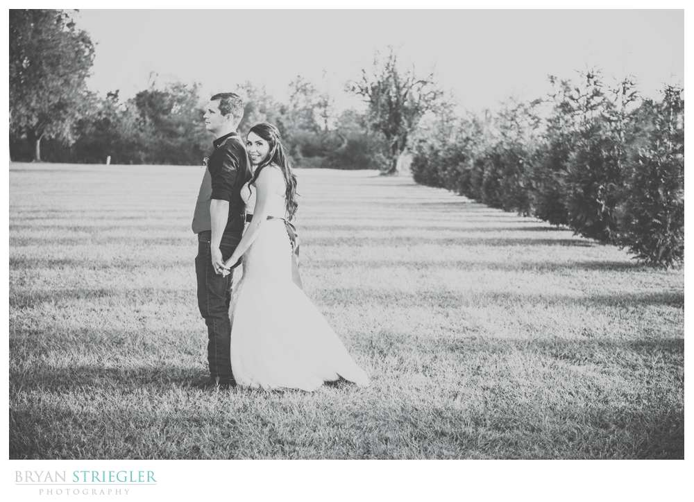 black and white portrait of bride hugging groom
