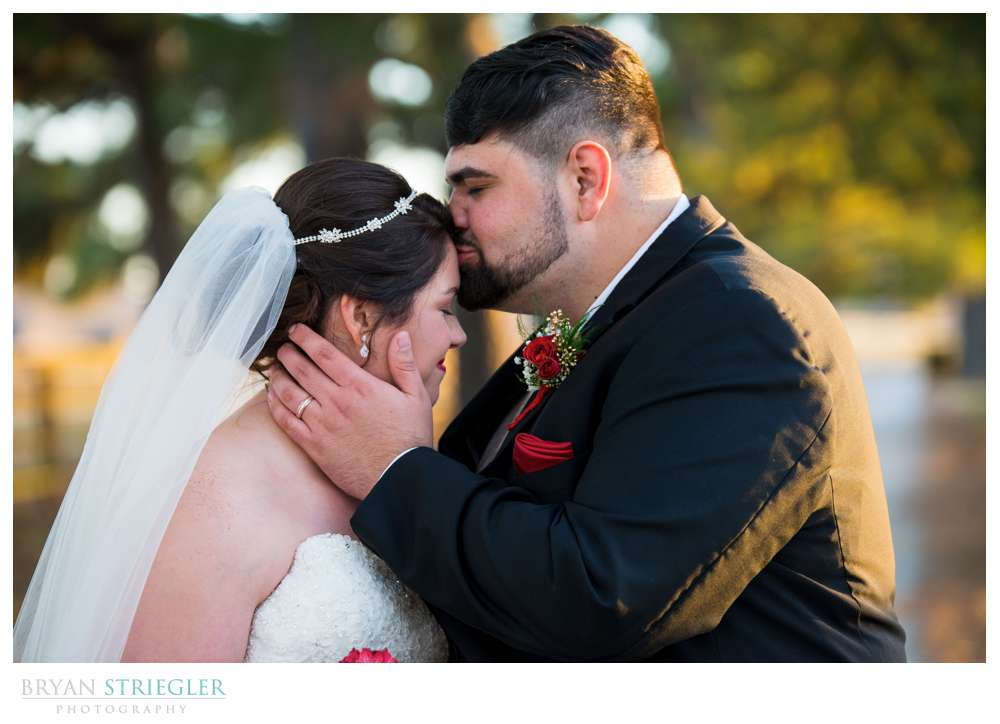 kissing bride's forehead