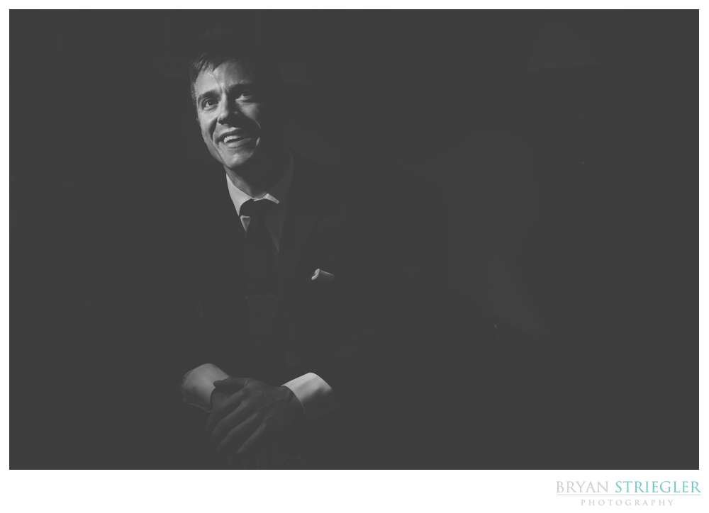 Black and white portrait of the groom low key