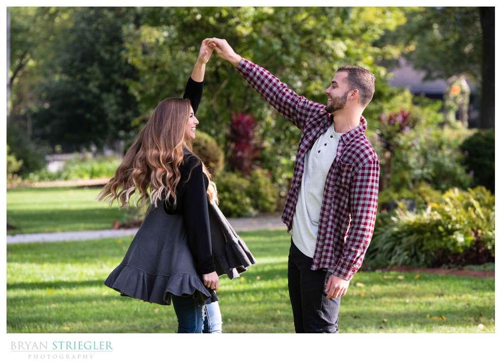 guy spinning girl