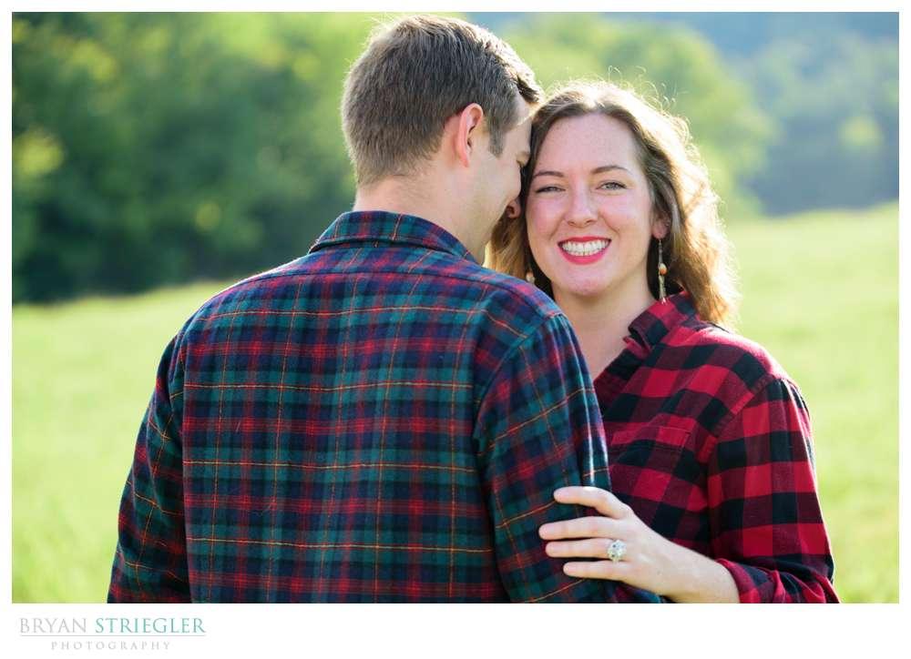 engagement photo with plaid shirts