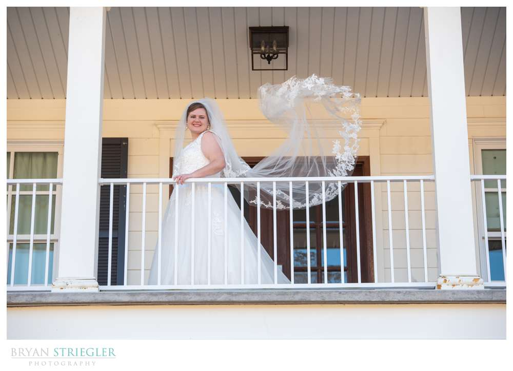 bride with tossed veil
