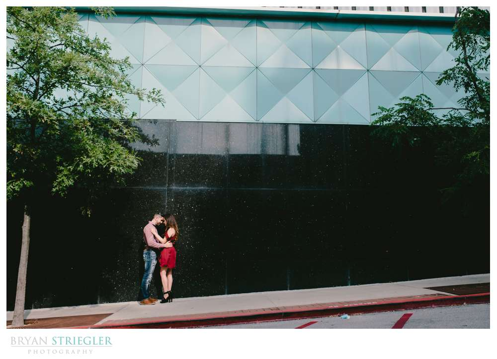 engagement couple with a cool building