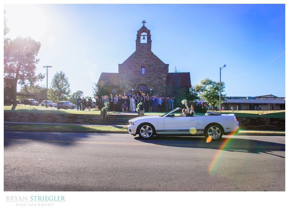 couple leaving the church in a car