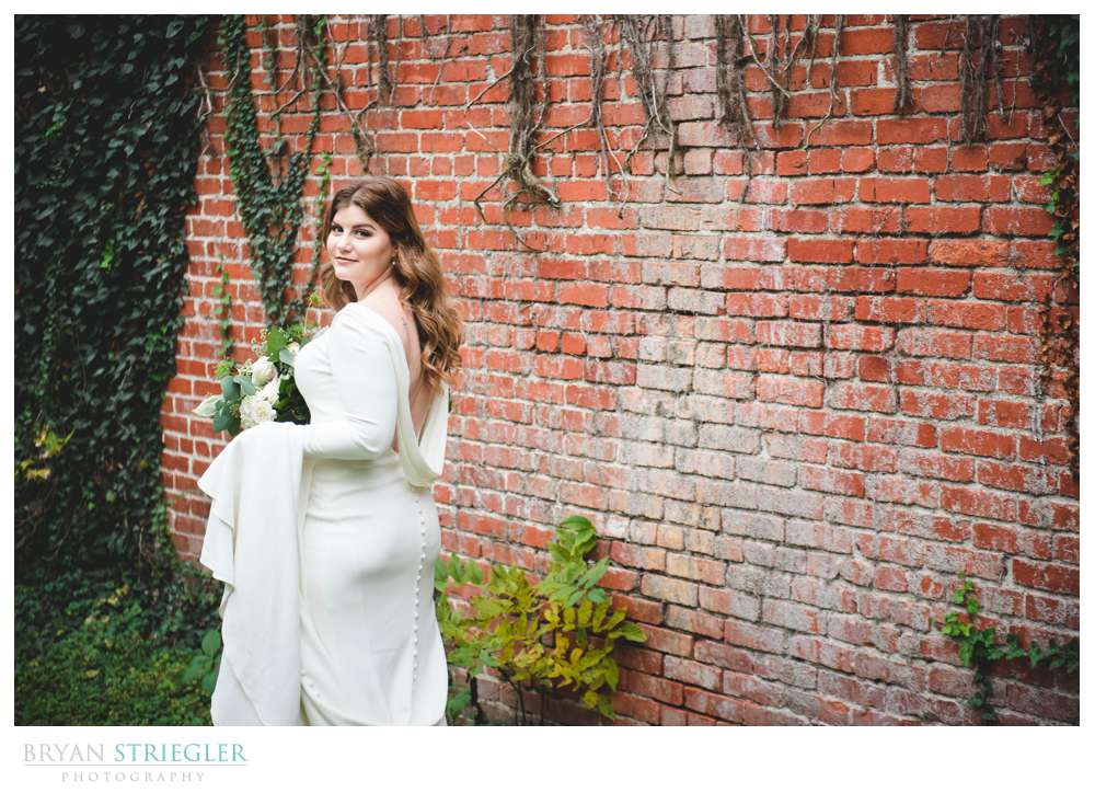 bridal portrait with bricks and ivy