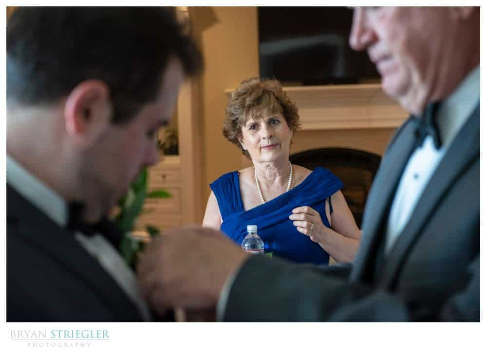 mother watching groom and husband