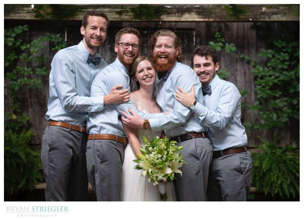 groomsmen hugging bride