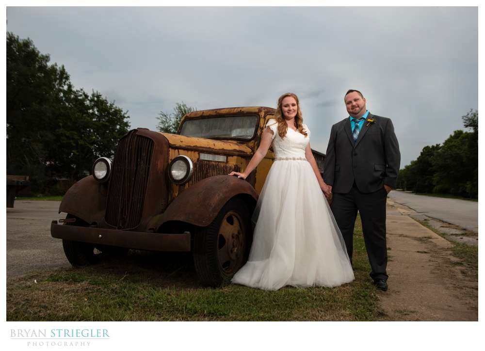 dramatic wedding photo with old truck