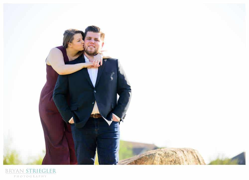 hugging fiance from behind