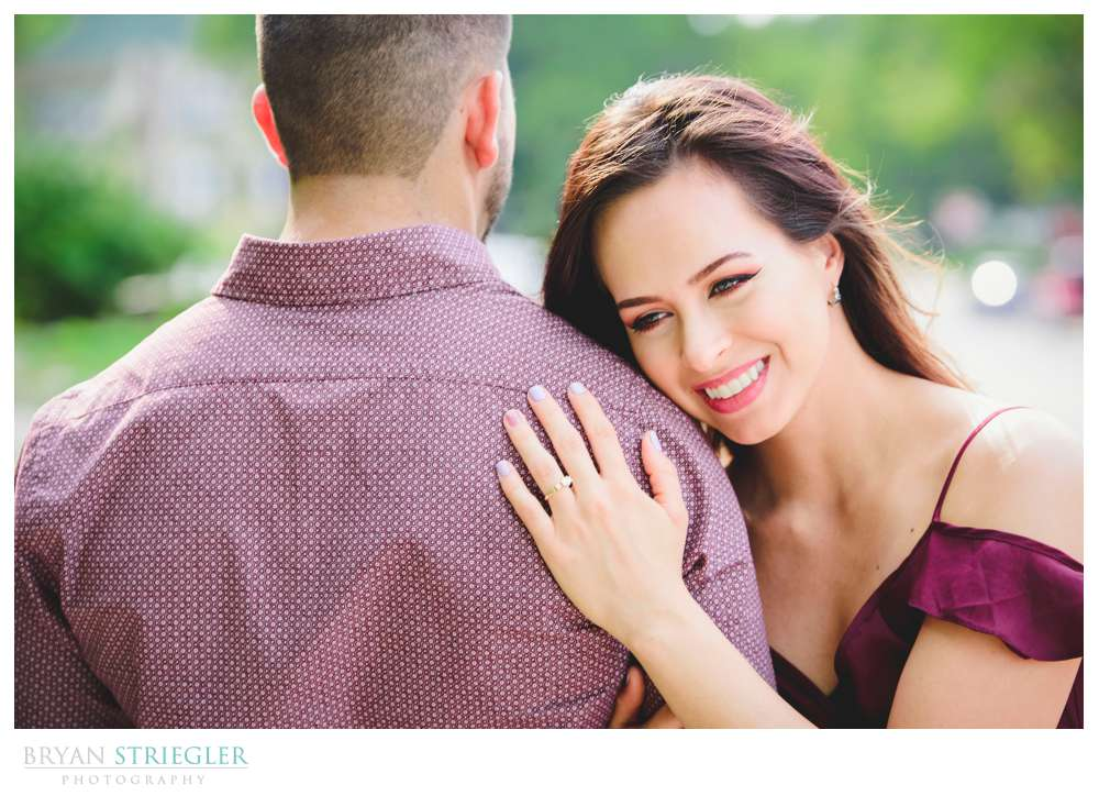 showing off the ring during an engagement shoot