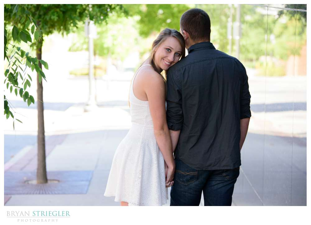 engagement photos leaning on fiance