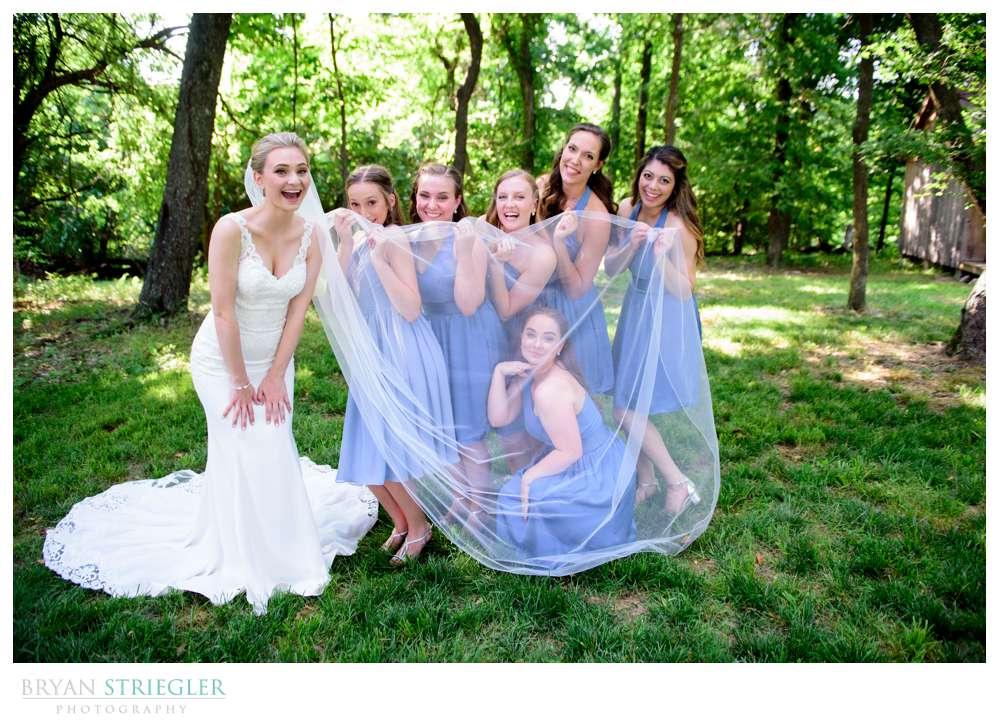 bridesmaid hiding under veil