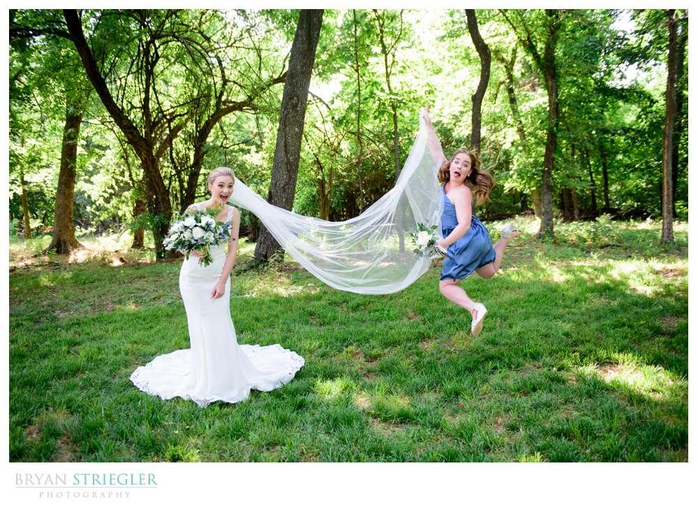 bridesmaid jumping with vail