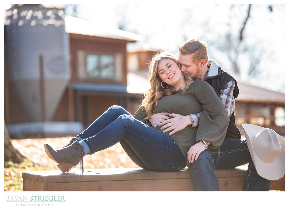 engagement photo on a bench