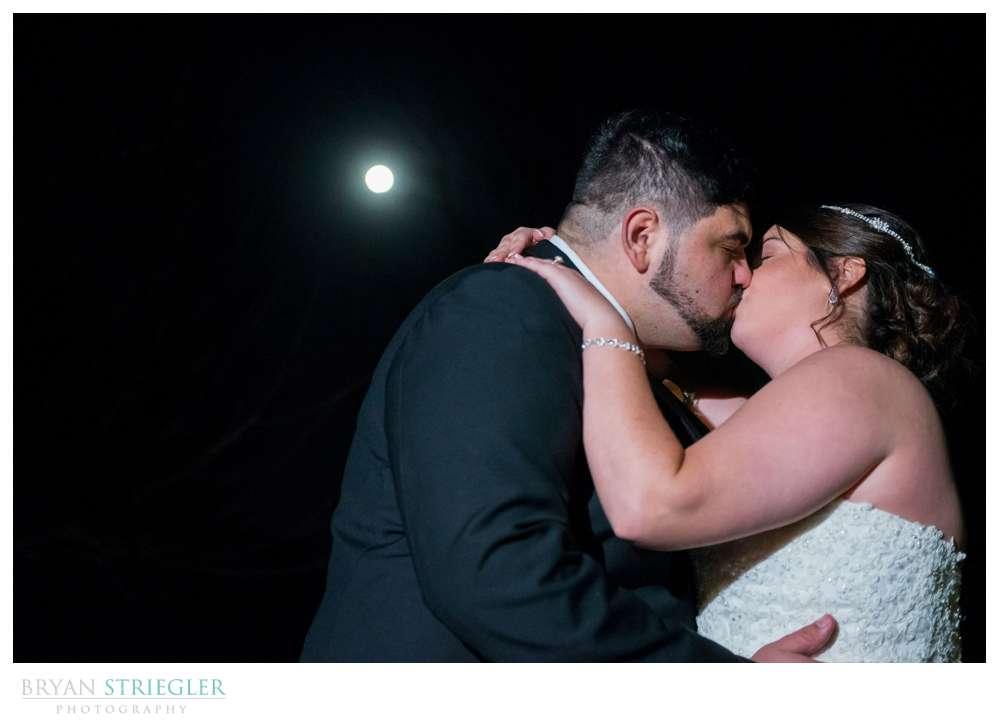 kissing under a full moon