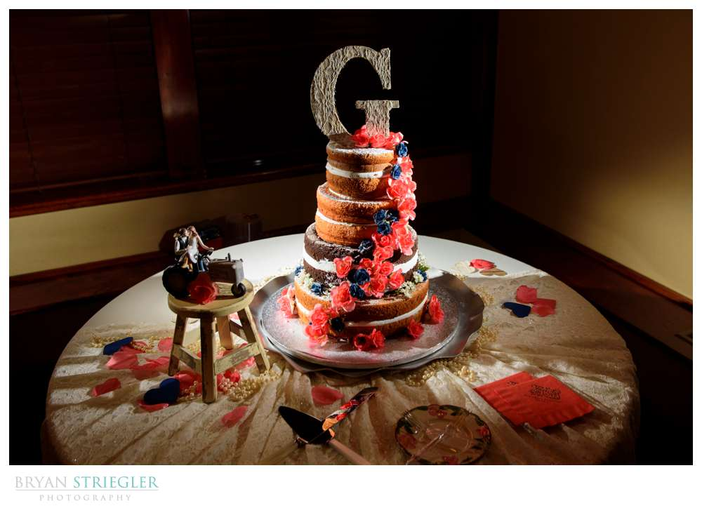 naked wedding cake and tractor topper