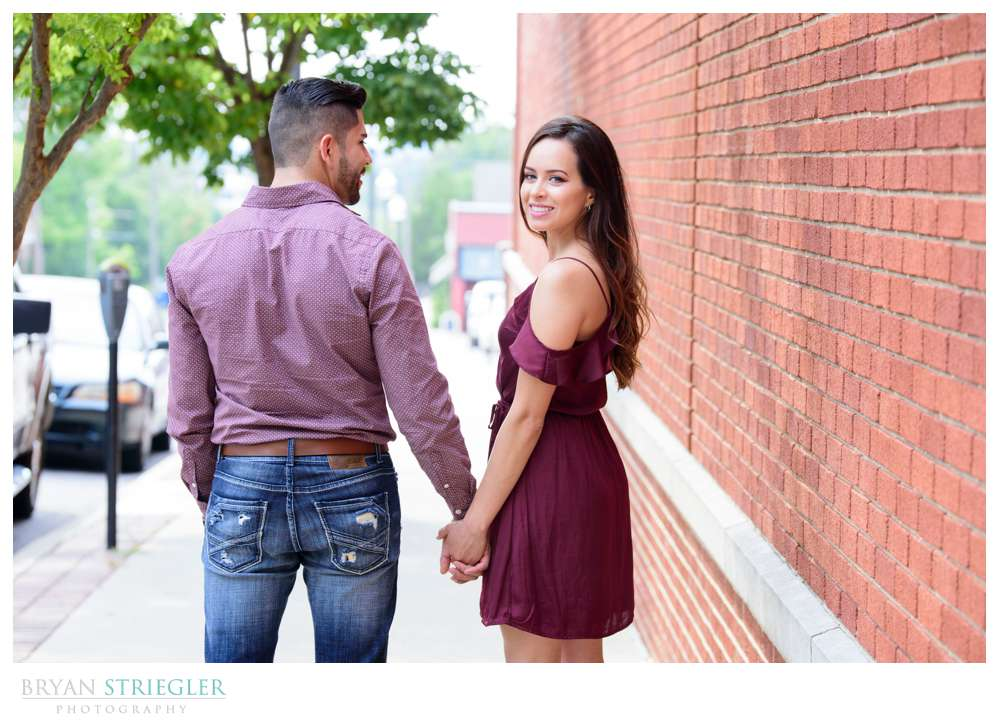 couple holding hands and looking back