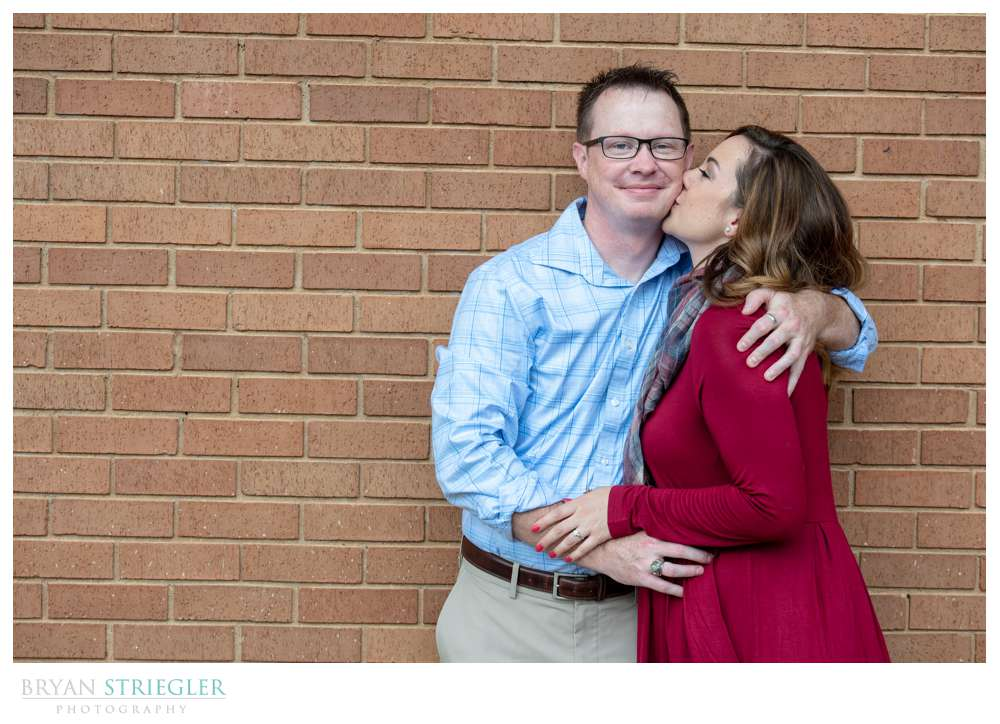 engagement photos by brick wall
