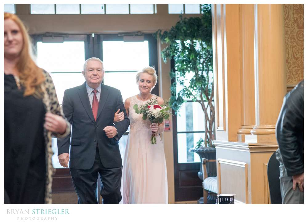 bride walking the aisle at Springdale Country Club