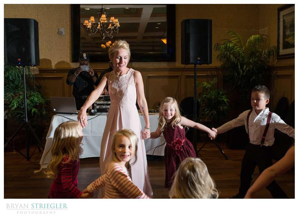 bride spinning with children
