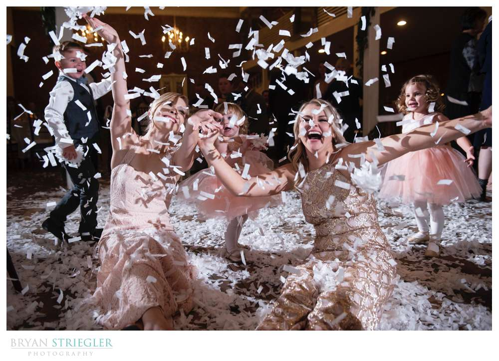 bridesmaids playing in confetti