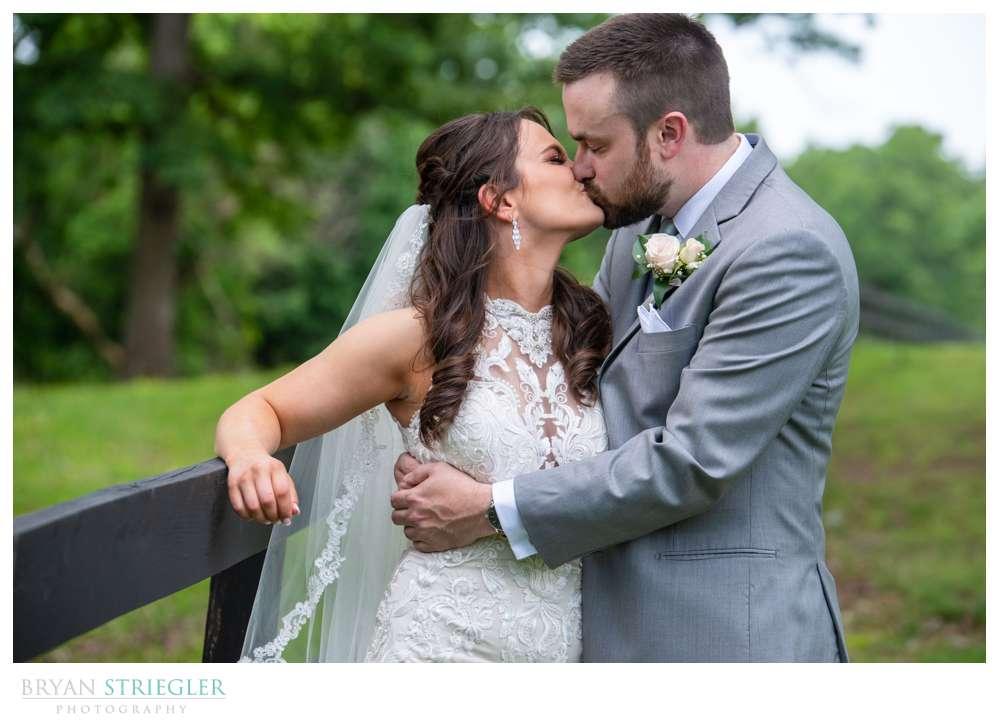 wedding couple against fence