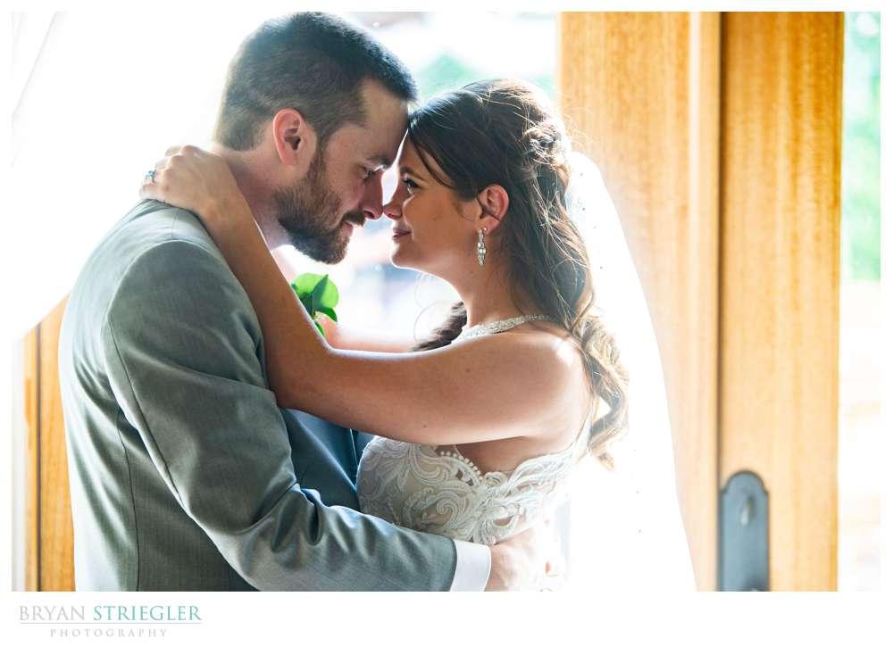 wedding couple in front of doors