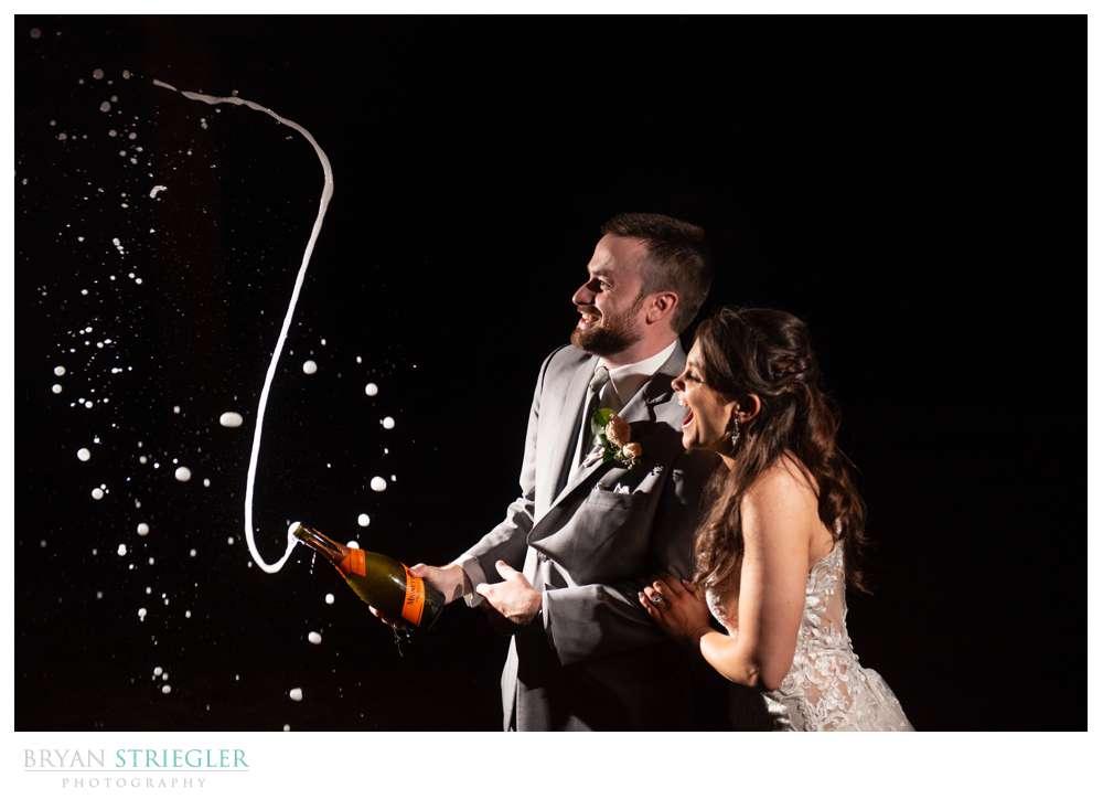 wedding couple shooting champagne