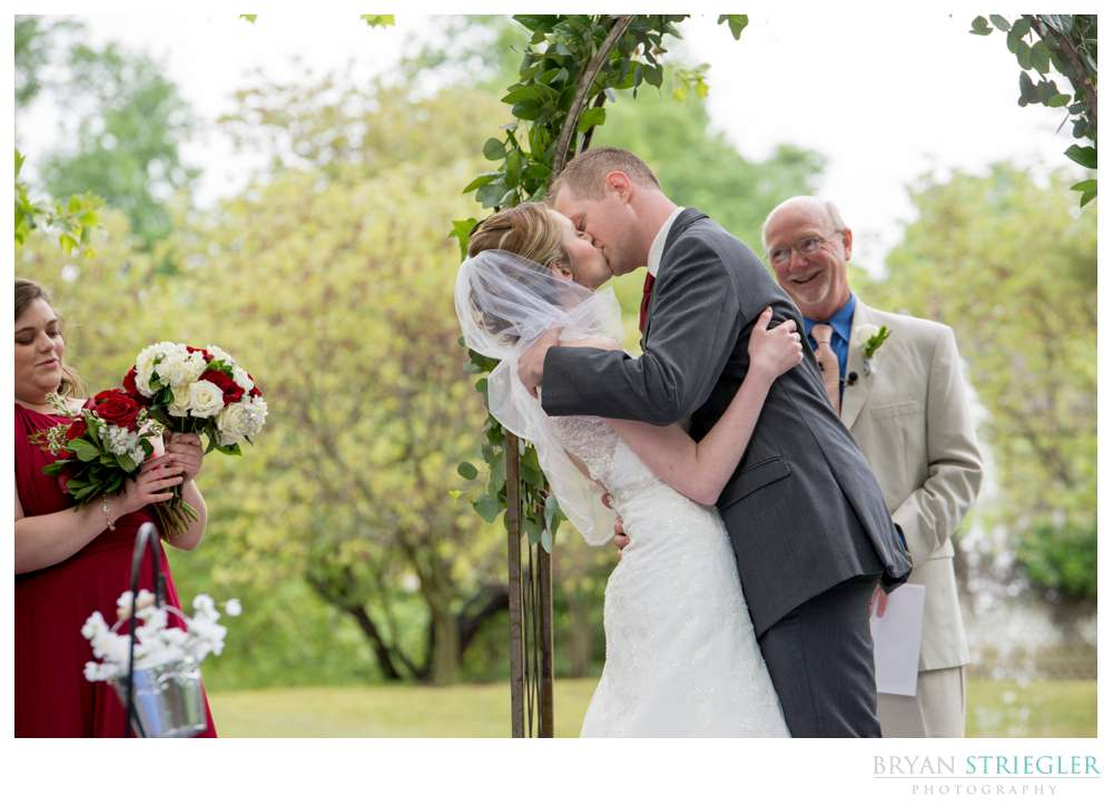 wedding ceremony kiss at outdoor wedding