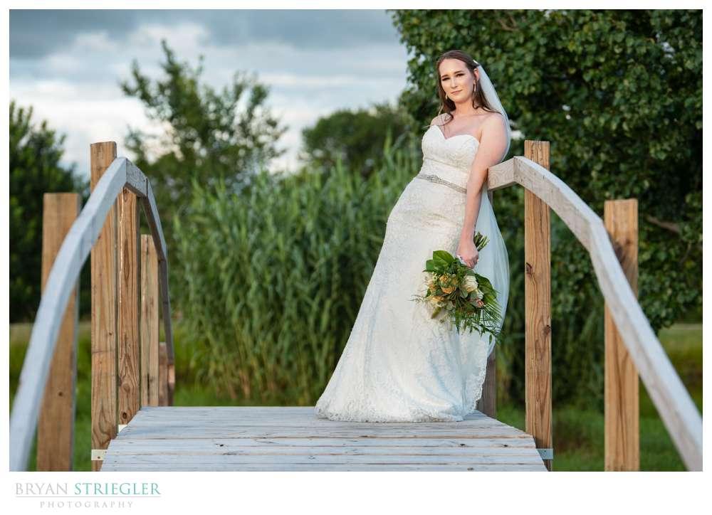 bride leaning on bridge