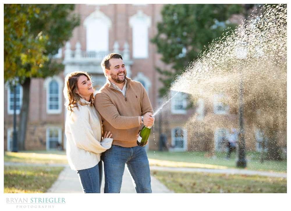opening champagne engagement photo