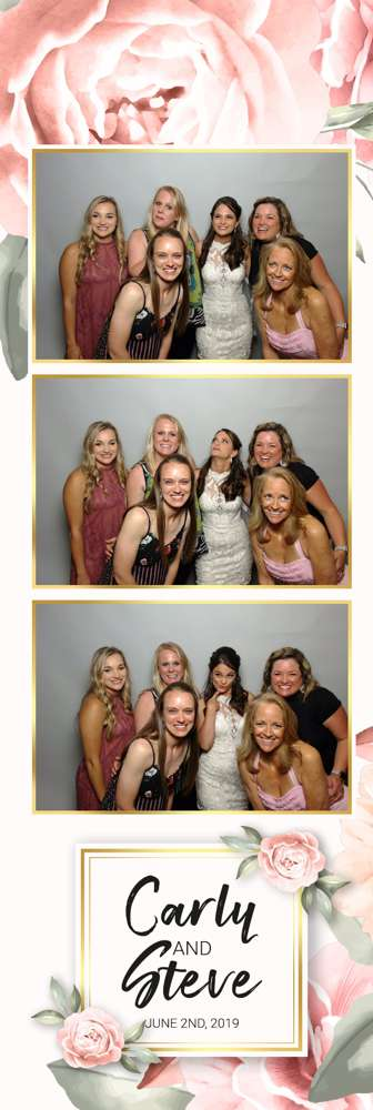 bride with girls in photo booth