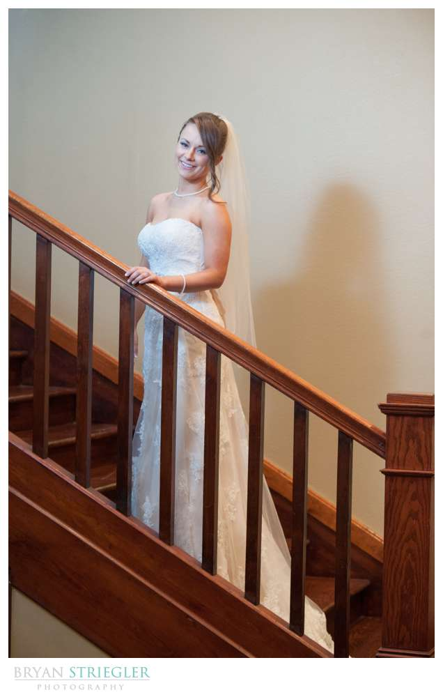 dramatic Rogers bridal portraits on stairs