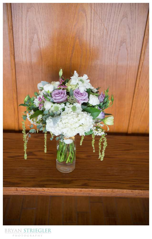 Fayetteville wedding photographer bouquet on wood bench