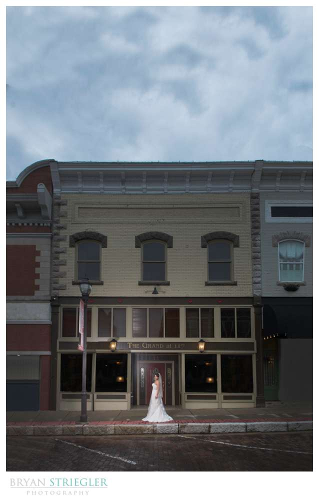 dramatic Rogers bridal portraits in front of The Grand at 117